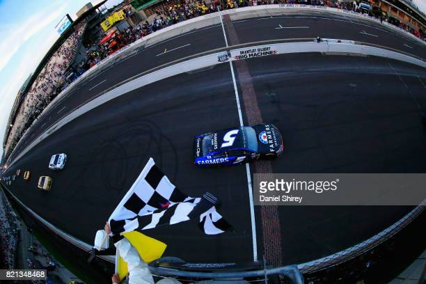 Kasey Kahne, driver of the Farmers Insurance Chevrolet, takes the checkered flag under caution to win the Monster Energy NASCAR Cup Series Brickyard...