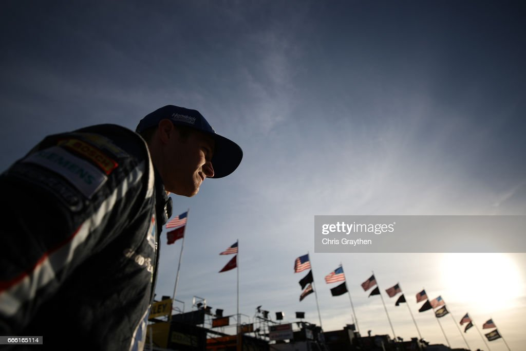 Kasey Kahne, driver of the #5 Farmers Insurance Chevrolet, walks through the garage area during practice for the Monster Energy NASCAR Cup Series O'Reilly Auto Parts 500 at Texas Motor Speedway on April 8, 2017 in Fort Worth, Texas.