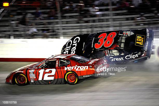 Kasey Kahne driver of the Great Clips Toyota hits the wall after an incident wit Justin Allgaier driver of the Verizon Wireless Dodge during the...