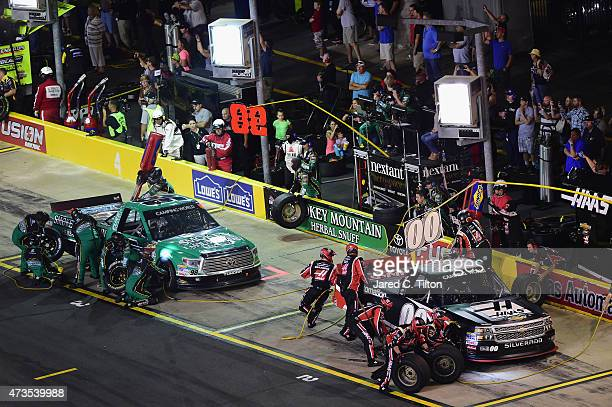 Kasey Kahne driver of the Haas Automation Chevrolet and Johnny Sauter driver of the Smokey Mountain/Curb Records Toyota pit during the NASCAR Camping...