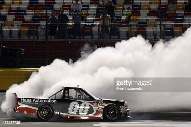 Kasey Kahne driver of the Haas Automation Chevrolet celebrates with a burnout after winning the NASCAR Camping World Truck Series North Carolina...