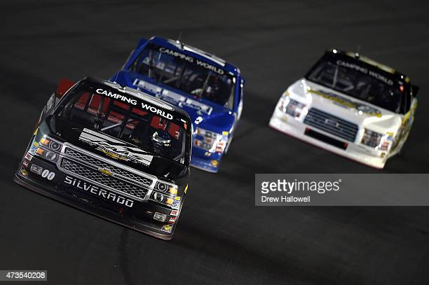 Kasey Kahne driver of the Haas Automation Chevrolet leads a pack of trucks during the NASCAR Camping World Truck Series North Carolina Education...