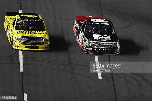 Kasey Kahne driver of the Haas Automation Chevrolet leads Erik Jones driver of the Dollar General Toyota during the NASCAR Camping World Truck Series...