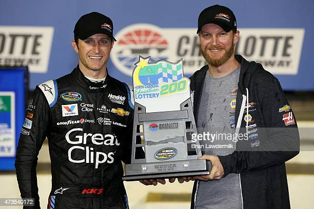 Kasey Kahne driver of the Haas Automation Chevrolet poses in victory lane with team owner Dale Earnhardt Jr after winning the NASCAR Camping World...