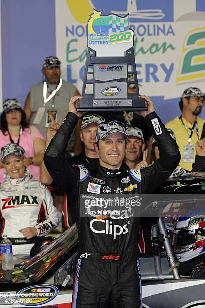Kasey Kahne driver of the Haas Automation Chevrolet poses in victory lane after winning the NASCAR Camping World Truck Series North Carolina...