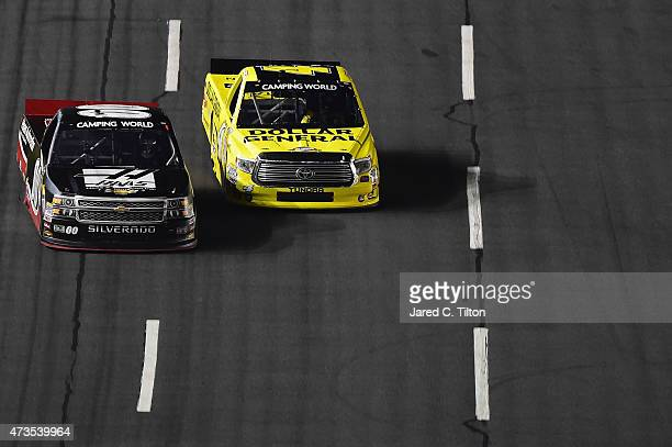 Kasey Kahne driver of the Haas Automation Chevrolet races Erik Jones driver of the Dollar General Toyota during the NASCAR Camping World Truck Series...