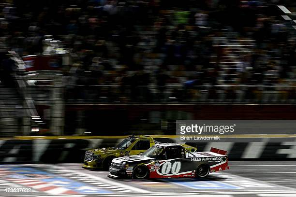 Kasey Kahne driver of the Haas Automation Chevrolet takes the checkered flag ahead of Erik Jones driver of the Dollar General Toyota to win the...