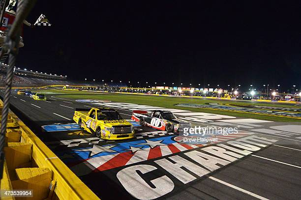 Kasey Kahne, driver of the Haas Automation Chevrolet, takes the checkered flag ahead of Erik Jones, driver of the Dollar General Toyota, to win the...