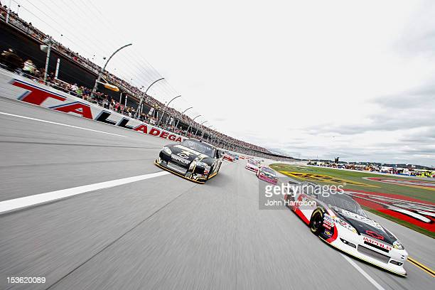 Kasey Kahne driver of the HendrickCarscom Chevrolet and Ryan Newman driver of the US Army Chevrolet lead the field during the pace laps prior to the...
