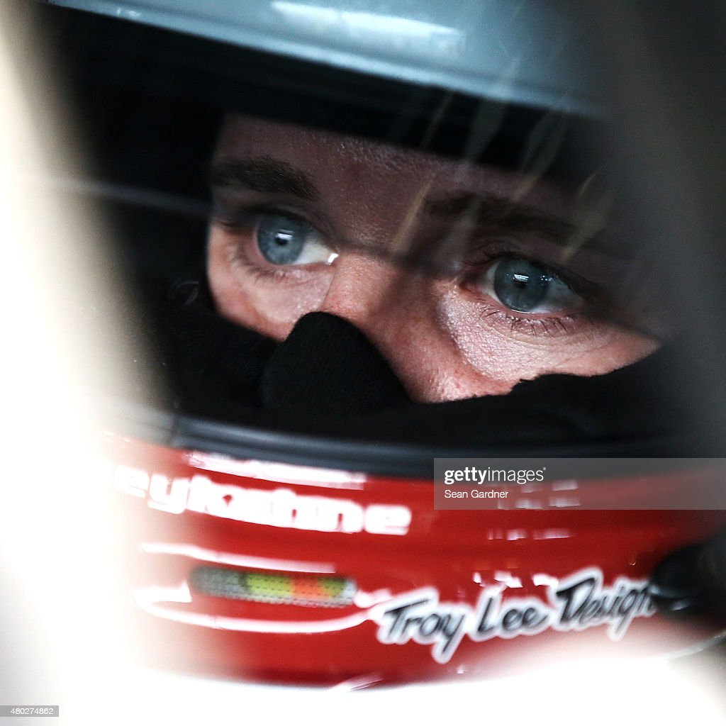 Kasey Kahne, driver of the #5 LiftMaster Chevrolet, sits in his car during practice for the NASCAR Sprint Cup Series Quaker State 400 Presented by Advance Auto Parts at Kentucky Speedway on July 10, 2015 in Sparta, Kentucky.