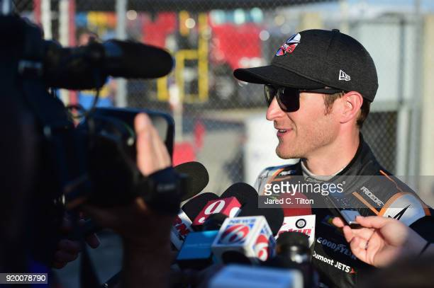 Kasey Kahne driver of the Procore Chevrolet speaks to the media outside the infield care center after an on track incident during the Monster Energy...