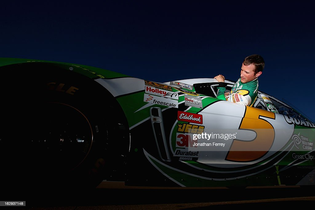 Kasey Kahne, driver of the #5 Quaker State Chevrolet, gets into his car during qualifying for the NASCAR Sprint Cup Series Subway Fresh Fit 500 at Phoenix International Raceway on March 1, 2013 in Avondale, Arizona.