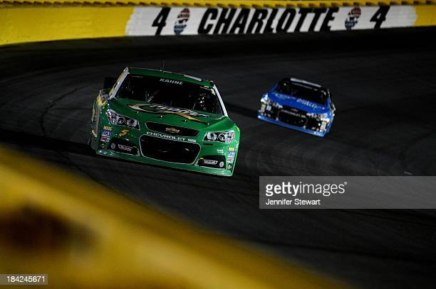 Kasey Kahne driver of the Quaker State Chevrolet leads Dale Earnhardt Jr driver of the Time Warner Cable Chevrolet during the NASCAR Sprint Cup...