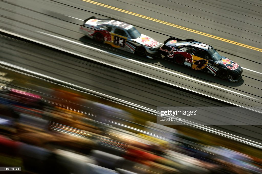Kasey Kahne, driver of the #4 Red Bull Toyota, and Brian Vickers, driver of the #83 Red Bull Toyota, draft during the NASCAR Sprint Cup Series Good Sam Club 500 at Talladega Superspeedway on October 23, 2011 in Talladega, Alabama.