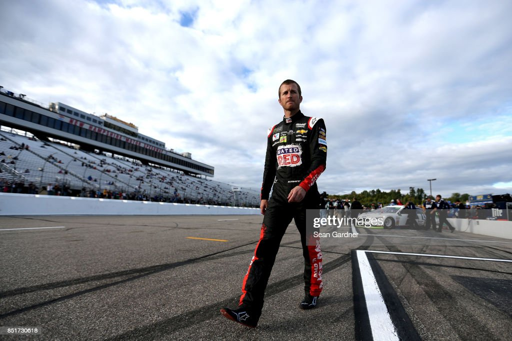Kasey Kahne, driver of the #5 Road to Race Day Chevrolet, walks on the grid during qualifying for the Monster Energy NASCAR Cup Series ISM Connect 300 at New Hampshire Motor Speedway on September 22, 2017 in Loudon, New Hampshire.