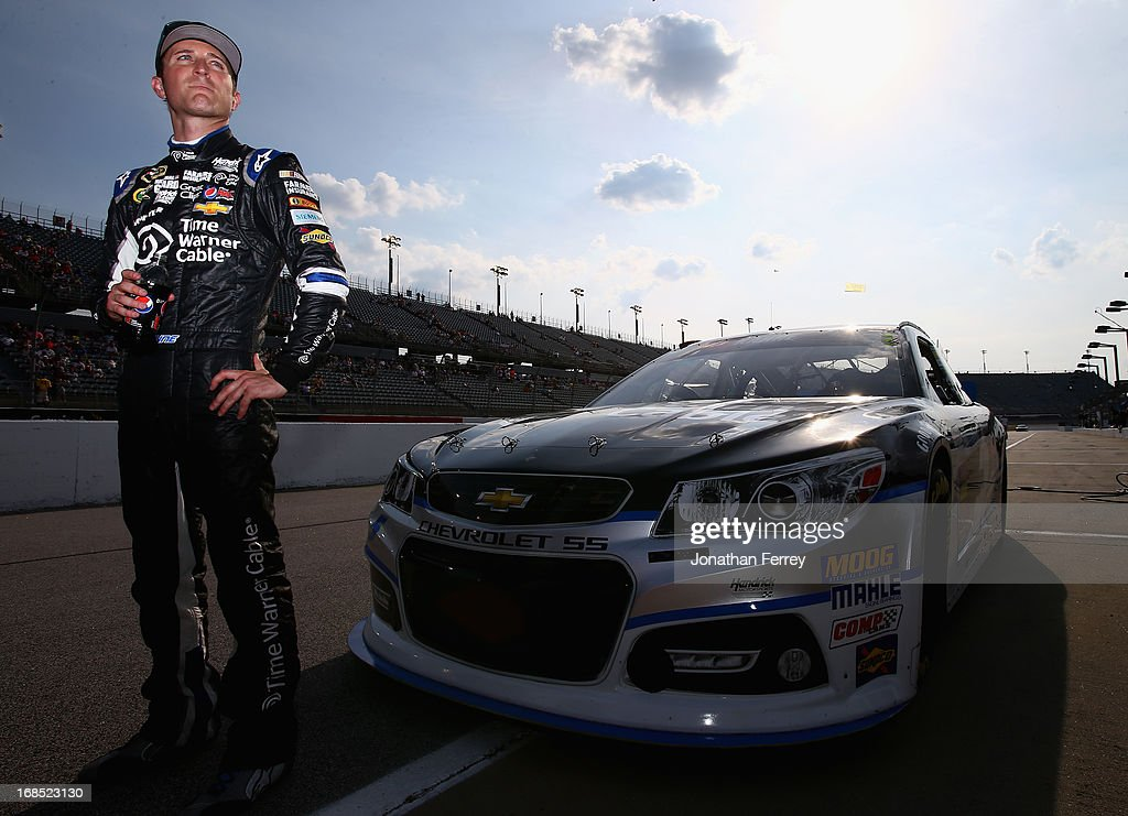 Kasey Kahne, driver of the #5 Time Warner Cable Chevrolet, stands by his car during qualifying for the NASCAR Sprint Cup Series Bojangles' Southern 500 at Darlington Raceway on May 10, 2013 in Darlington, South Carolina.