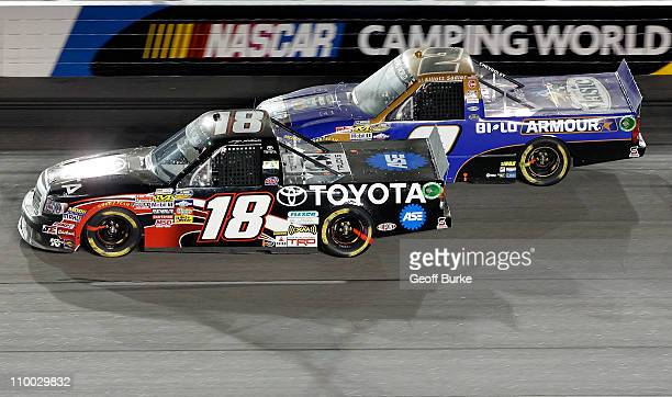 Kasey Kahne driver of the Toyota races Elliott Sadler driver of the Armour Vienna Sausages Chevrolet during the NASCAR Camping World Truck Series Too...