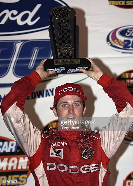 Kasey Kahne driver of the Ultra Motorsports Dodge celebrates winning the NASCAR Craftsman Truck Series Ford 200 on November 19 2004 at the Homestead...