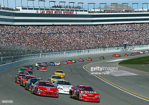 Kasey Kahne drives his Evernham Motorsports Dodge at the lead of the pack with Dale Earnhardt Jr during the NASCAR Nextel Cup UAWDaimler Chyrsler 400...