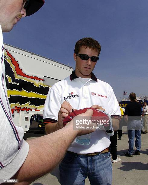 Kasey Kahne signs an autograph Sunday April 18 2004 before the NASCAR Advance Auto Parts 500 at Martinsville Speedway