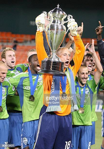 Kasey Keller of Seattle Sounders FC with the trophy after winning the US Open Cup 21 over DC United at RFK Stadium on September 2 2009 in Washington...