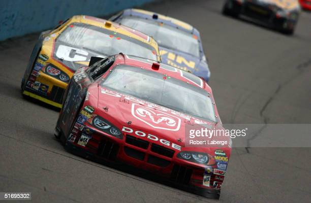 Kasey Khane driver of the Evernham Motorsports Dodge Dealers/UAW Dodge leads a pack of cars during the NASCAR Nextel Cup Series Checker Auto Parts...