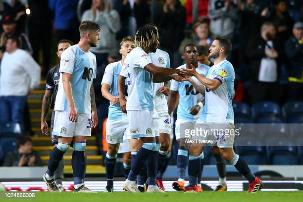 Kasey Palmer of Blackburn Rovers celebrates with team mates after scoring their fourth goal during the Carabao Cup Second Round match between...
