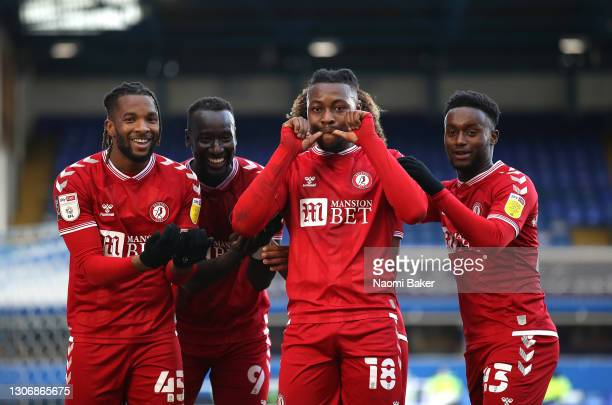 Kasey Palmer of Bristol City celebrates with teammates Famara Diedhiou, Antoine Semenyo and Steven Sessegnon after scoring his team's first goal...