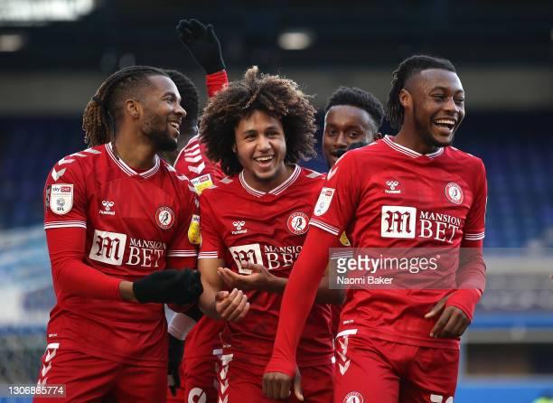 Kasey Palmer of Bristol City celebrates with teammates Han-Noah Massengo, Steven Sessegnon, and Antoine Semenyo after scoring his team's first goal...