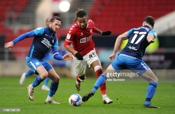 Kasey Palmer of Bristol City is challenged by Alan Browne of Preston North End and Benjamin Whiteman of Preston North End during the Sky Bet...