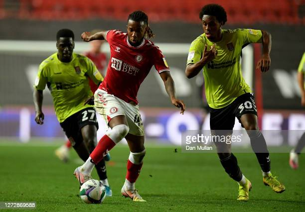 Kasey Palmer of Bristol City is challenged by Caleb Chukwuemeka of Northampton Town during Carabao Cup Second Round match between Bristol City and...