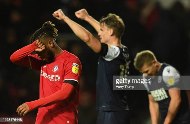 Kasey Palmer of Bristol City reacts at the final whistle as Matt Smith of Millwall celebrate during the Sky Bet Championship match between Bristol...