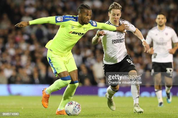 Kasey Palmer of Derby and Stefan Johansen of Fulham battle for the ball during the Sky Bet Championship Play Off Semi FinalSecond Leg match between...