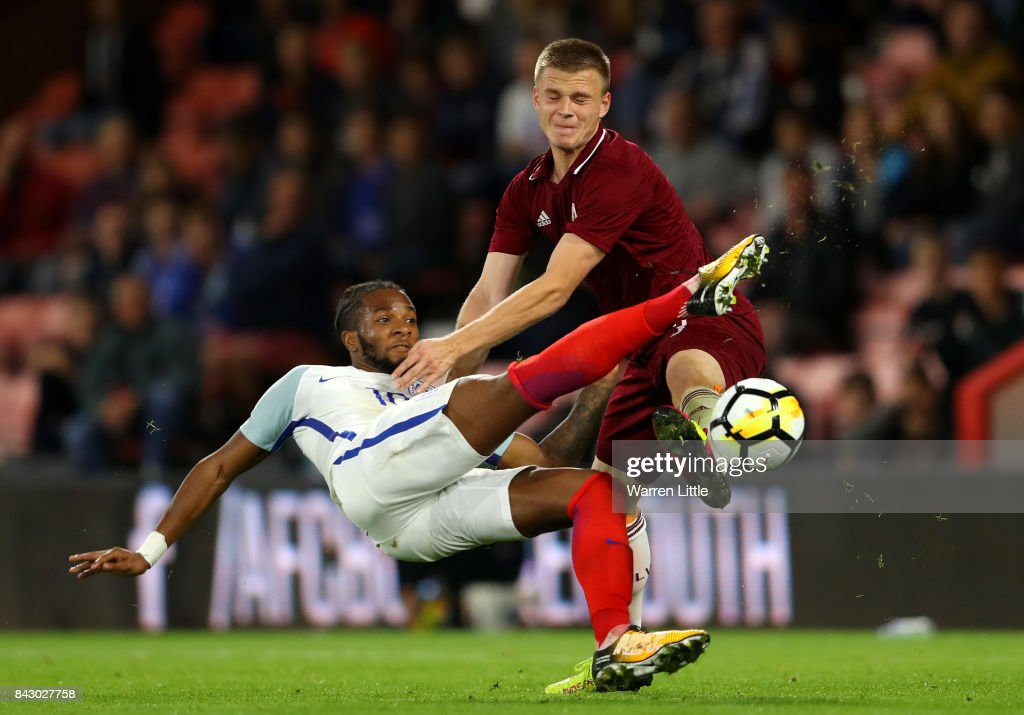 Kasey Palmer of England and Viktors Litvinskis of Latvia in action during the UEFA Under 21 Championship Qualifiers between England and Latvia at Vitality Stadium on September 5, 2017 in Bournemouth, England.