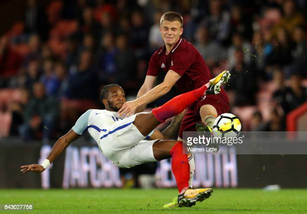 Kasey Palmer of England and Viktors Litvinskis of Latvia in action during the UEFA Under 21 Championship Qualifiers between England and Latvia at...