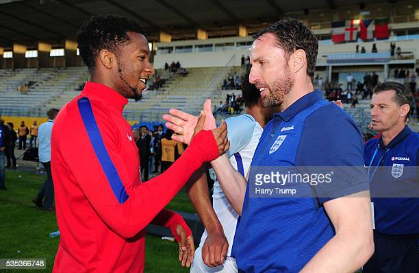 Kasey Palmer of England celebrates with Gareth Southgate Coach of England during the Final of the Toulon Tournament between England and France at...