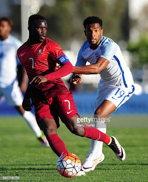 Kasey Palmer of England is tackled by Romario Balde of Portugal during the Toulon Tournament match between England and Portugal at Stadium Leo...