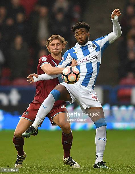 Kasey Palmer of Huddersfield is tackled by Nathan Smith of Port Vale during The Emirates FA Cup Third Round match between Huddersfield Town and Port...