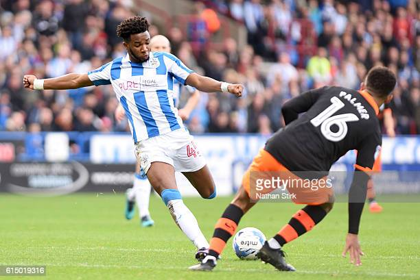 Kasey Palmer of Huddersfield Town and Liam Palmer of Sheffield Wednesday in action during the Sky Bet Championship match between Huddersfield Town...