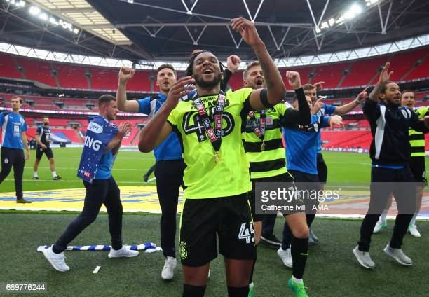 Kasey Palmer of Huddersfield Town celebrates promotion after the Sky Bet Championship Play Off Final match between Reading and Huddersfield Town at...