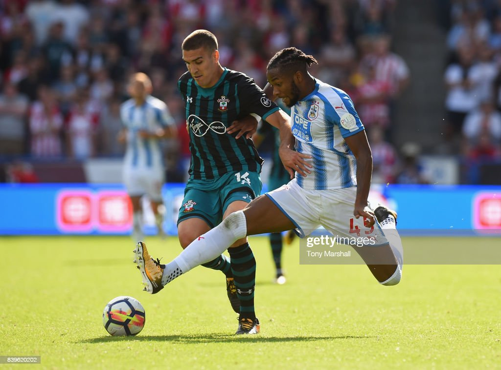 Kasey Palmer of Huddersfield Town tackles Oriol Romeu of Southampton during the Premier League match between Huddersfield Town and Southampton at Galpharm Stadium on August 26, 2017 in Huddersfield, England.