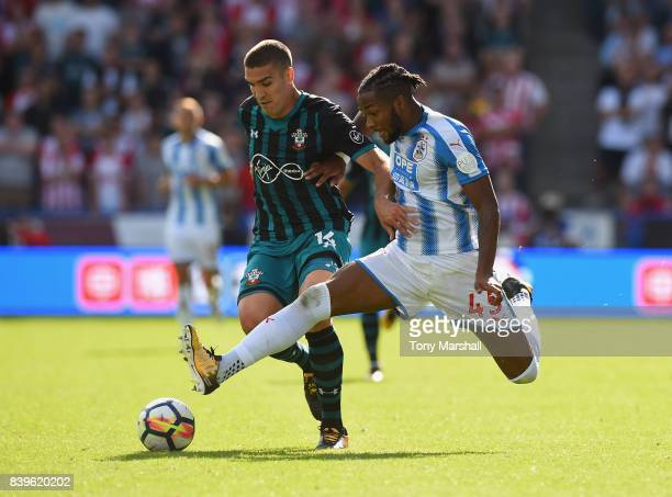Kasey Palmer of Huddersfield Town tackles Oriol Romeu of Southampton during the Premier League match between Huddersfield Town and Southampton at...