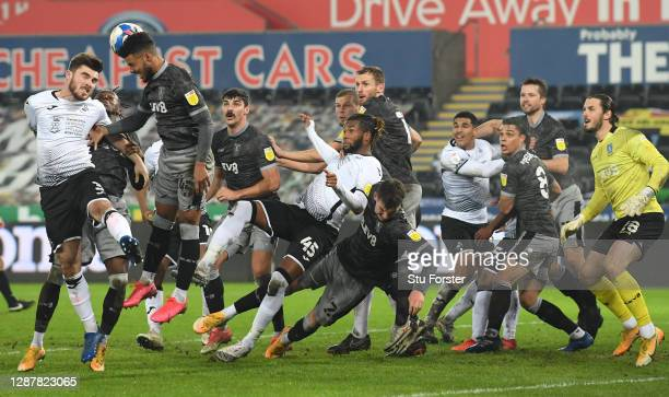 Kasey Palmer of Swansea City and team mates up for a last minute corner cause bedlum in the penalty area during the Sky Bet Championship match...