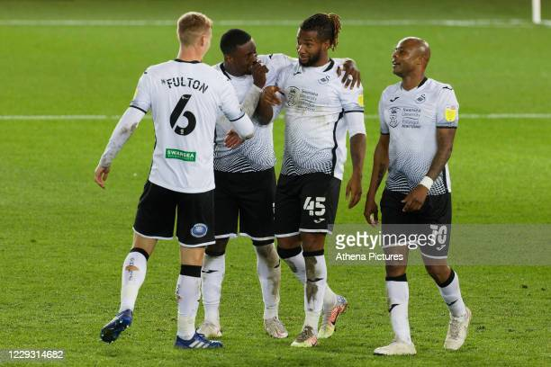 Kasey Palmer of Swansea City celebrates his goal with team mates Jay Fulton Marc Guehi and Andre Ayew during the Sky Bet Championship between Swansea...