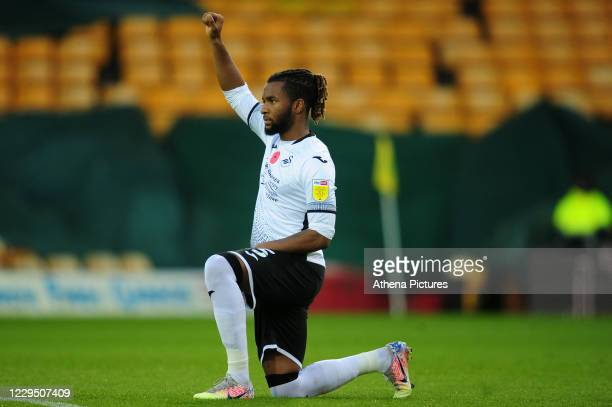Kasey Palmer of Swansea City takes a knee ahead of the Sky Bet Championship match between Norwich City and Swansea City at Carrow Road on November...