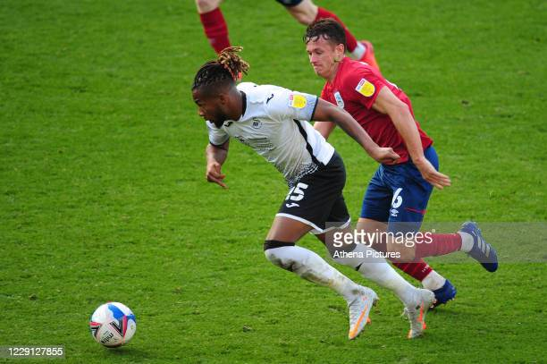 Kasey Palmer of Swansea City vies for possession with Jonathan Hogg of Huddersfield Town during the Sky Bet Championship match between Swansea City...