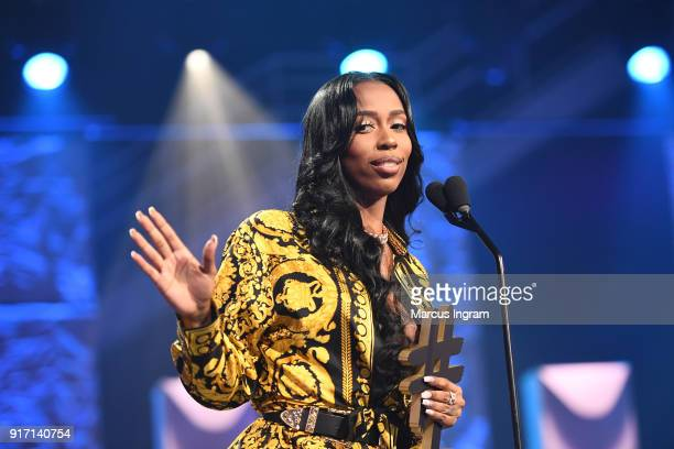 Kash Doll accepts an award onstage during BET's Social Awards 2018 at Tyler Perry Studio on February 11 2018 in Atlanta Georgia