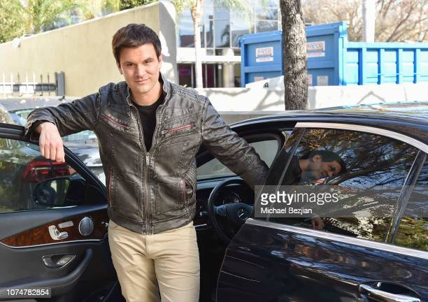 Kash Hovey posing with Mercedez Benz Encino at Visual Snow Initiative Celebrates GIVINGTUESDAY At The Artists Project on November 27 2018 in Los...