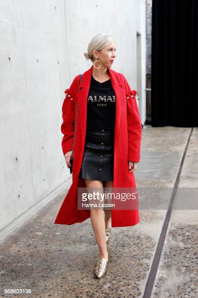 Kash O'Hara wearing Mother of Pearl coat Balmain top Rebecca Minkoff mules and Chanel bag during MercedesBenz Fashion Week Resort 19 Collections at...