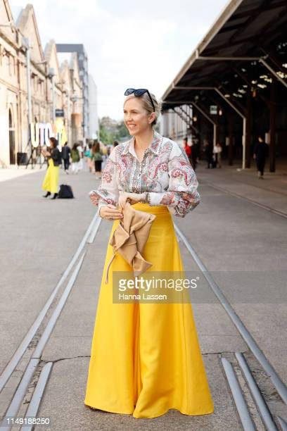 Kash Ohara wearing Yves Saint Laurent sunglasses Zimmerman top yellow wide pants at MercedesBenz Fashion Week Resort 20 Collections on May 15 2019 in...